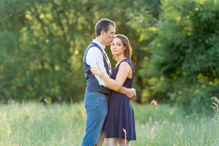 Couples embrace for Engagement Shoot in the setting sun at Cow Common