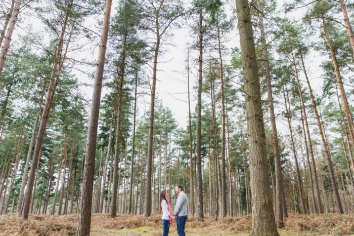 Couple holding hands in Minley Woods
