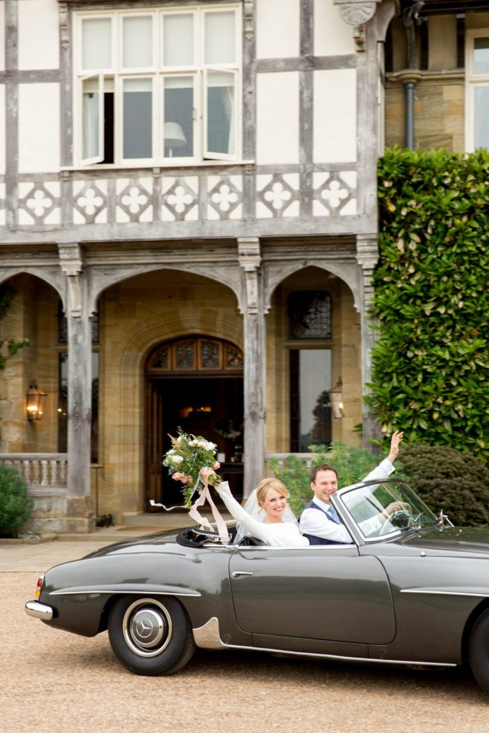 Bride and Groom Drive Away in Style