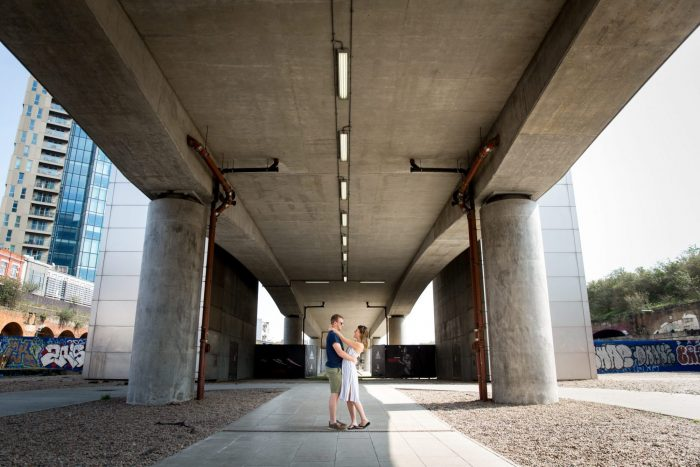 Megan and Sam under the bridge in shoreditch on their engagement shoot with LaHu