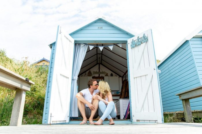 Beach Hut Engagement Photography Session at Milford