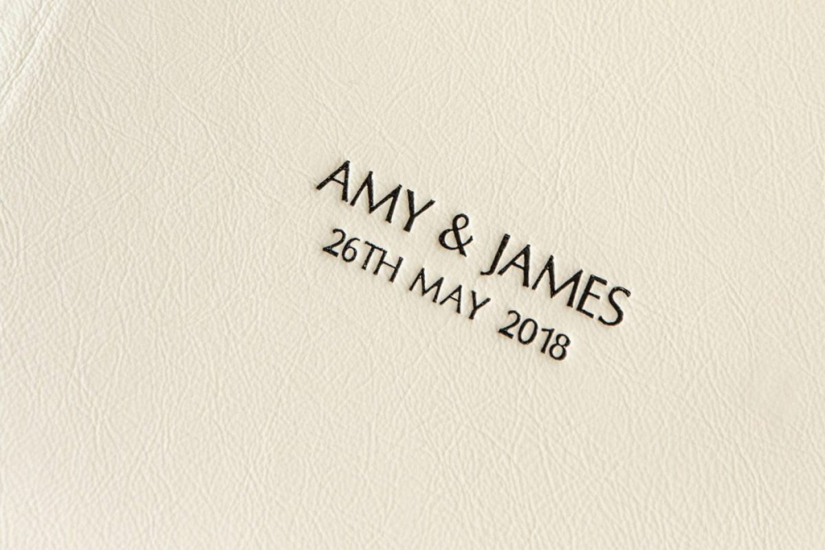 Laser Etched Cream Leather Cover of a  Luxury Wedding Album by LaHu