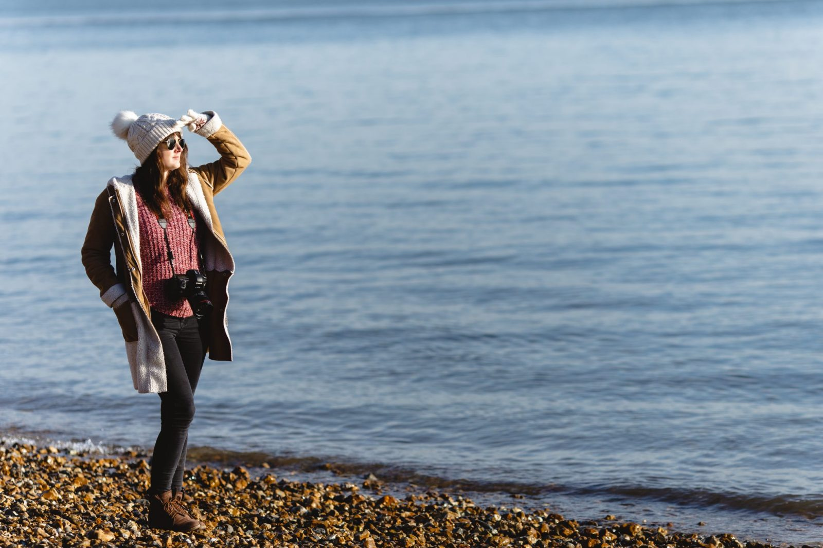 Lauren of Lahu Wedding Photography posing on Lepe Beach, Hampshire