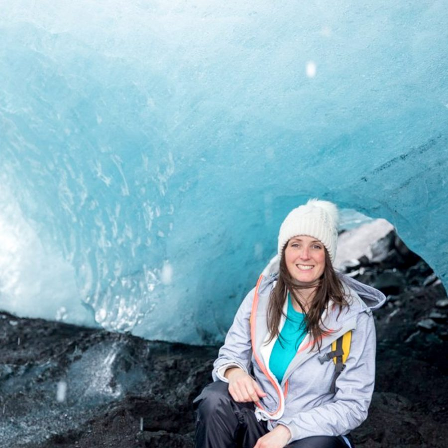 Explorer-woman-in-a-glacier-in-iceland