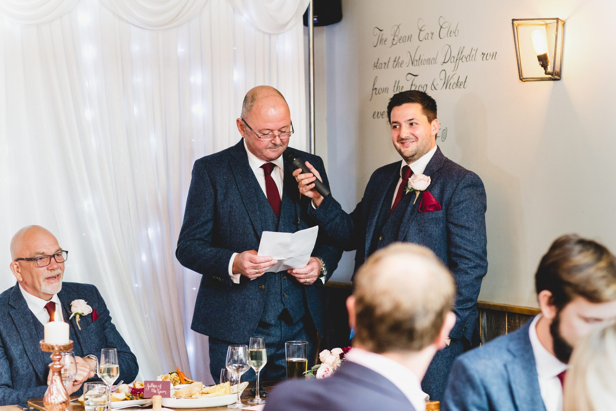 father of groom giving speech at frog and wicket pub