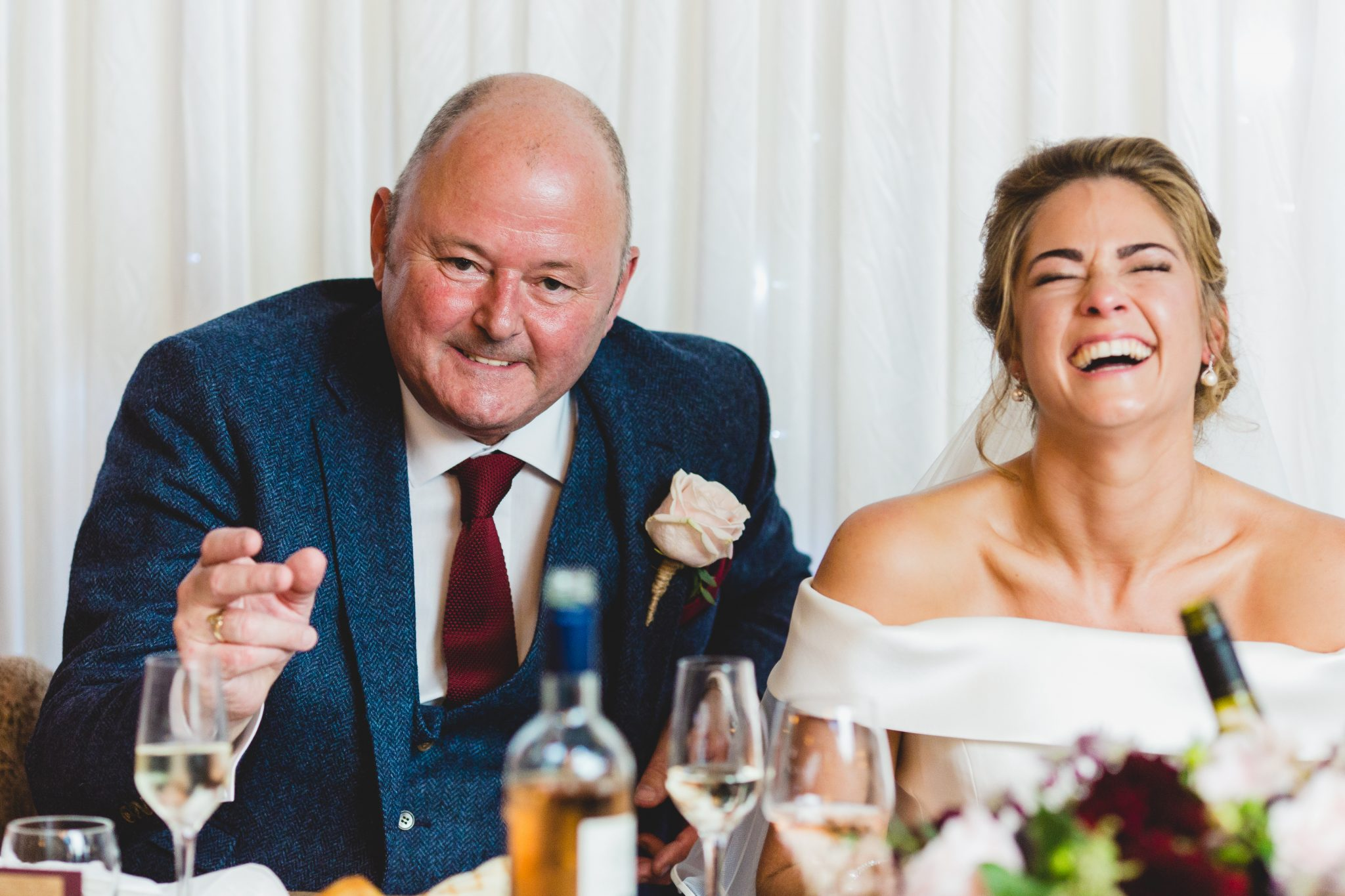 bride laughing during speeches at frog and wicket pub