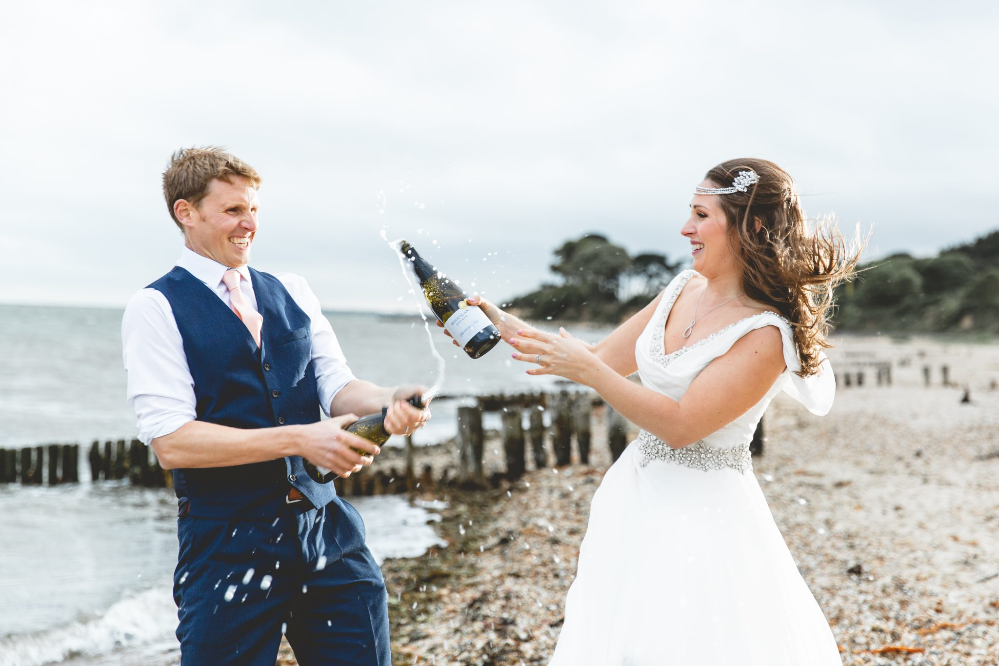 newly weds pop the champagne and spray each other
