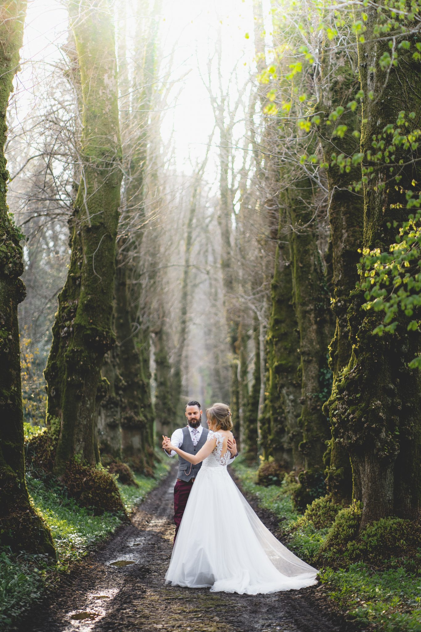 Bride and Groom down the Lime Avenue, Pentillie Castle Wedding